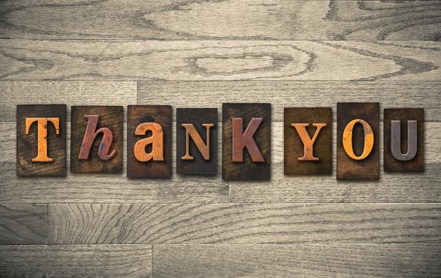 "The words ""THANK YOU"" written in vintage wooden letterpress type."